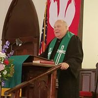 Pastor Harry Gindhart leading the congregation.