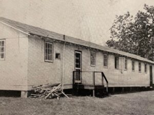 The war surplus trailer used for the Educational Building